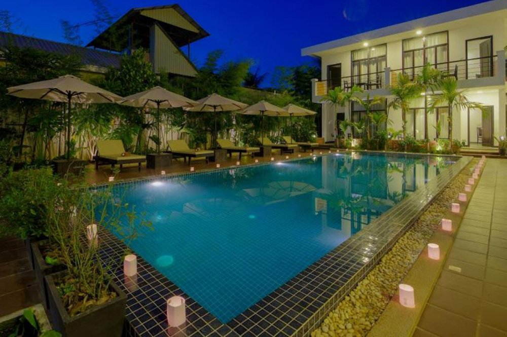 nomadic mick la rose blanche boutique hotel swimming pool siem reap cambodia